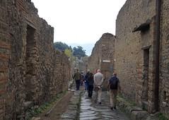 Italy (Napoli)  Pompeii visitors even at rainy day (ustung) Tags: candid italy napoli naples pompeii vesuvius outdoor architectire road ancient city ruins nikon