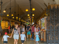 cloth hall (stevefge) Tags: krakow poland oldtown clothhall gate arcade shop lamps renaissance people family summer zomer reflectyourworld