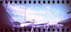 film (La fille renne) Tags: film analog 35mm lafillerenne sprocketrocket lomochrome lomochromepurple lomochromepurplexr100400 purple sea roadtrip travel cavalaire boats panorama