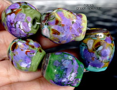 Rocks Green Splendor (Laura Blanck Openstudio) Tags: openstudio openstudiobeads glass handmade murano lampwork torched beads bead set big artist art arts fine artisan made usa rocks pebbles stones frit whimsical funky odd earthy organic abstract colrful multicolor lilac grape lavender purple violet jewelry published show winner festival italian argentinian shiny green ocher copper amber rare unique porcelain aqua blue turquoise