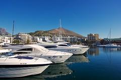 Docked (jmschrei) Tags: capetown da15ltd marina pentaxk5 reflections sailboats signalhill southafrica water waterfront yachts