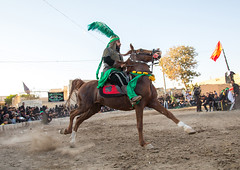 Man riding a horse during a traditional religious theatre called tazieh about imam hussein death in kerbala, Isfahan province, Isfahan, Iran (Eric Lafforgue) Tags: 9people artscultureandentertainment ashura battle ceremony clothing colorimage commemoration condolencetheater drama epic esfahan fullframe fulllength groupofpeople historicalreenactment history horizontal horse imamhussein iran iranian isfahan islam ispahan knight men middleeast mourning muharram muslim outdoors periodcostume persia photography play religion religiouscelebration shia shiism shiite tazieh theatre women isfahanprovince ir