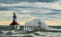 St Joseph lighhouse under attack...Explore (Kevin Povenz Thanks for the 3,000,000 views) Tags: 2016 november kevinpovenz westmichigan berriencounty stjoseph lighthouse waves bigwave weather stormyweather stormy storm wind snow rain clouds lakemichigan canon7dmarkii sky water red white cold