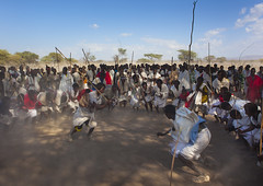 Karrayyu Tribe Men During Choreographed Stick Fighting Dance During Gadaaa Ceremony, Metahara, Ethiopia (Eric Lafforgue) Tags: adult adultonly africa african color colorimage colour cultural dance dancing day developingcountry dust dusty eastafrica emotion energy eth128868 ethiopia ethnicgroup ethnicity excitement gaada gada gadasystem gadaa groupofpeople groupofpersons haircut hairstyle harar horizontal hornofafrica indigenousculture journey karotribe karrayu karrayyu kereyu largegroupofpeople lifestyle man metehara misraqshewazone mobility motion moving native nomadic oromiaregion oromo outdoors pastoralist people photography realpeople tradition traditional traditionalceremony traditionalclothing traditionalculture traveldestinations tribal tribaldancing typical warrior