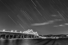 Tappan Zee Bridge (Mike Orso) Tags: longexposure travel bridge blackandwhite ny newyork motion reflection metal architecture night print photography photo scenery gallery image fineart stock scenic canvas astrophotography license hudsonriver starburst startrails tappanzee sleepyhollow tarrytown mikeorso