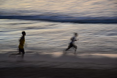 Boys running on the beach (Simon_sees) Tags: travel sunset vacation people bali holiday blur beach boys water sport indonesia sand asia surf locals exercise running run jimbaranbay