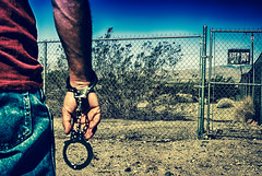 Never Anger A Posse Of Cats (hbmike2000) Tags: sign rock fence sand nikon gate desert arm d200 hdr handcuffs keepout lotsofthem breakfree ourdailychallenge hbmike2000