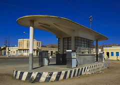 Old Colonial Italian Gas Station, Dekemhare, Eritrea (Eric Lafforgue) Tags: africa street travel color colour building horizontal architecture outdoors photography italian day garage colonial nobody nopeople oil artdeco decline futuristic clearsky oldfashioned eritrea hornofafrica eastafrica traveldestinations dekemhare eritreo buildingexterior colorpicture erytrea eritreia colourimage italiancolony  ertra    eritre eritreja eritria colourpicture  rythre africaorientaleitaliana     eritre eritrja  eritreya  erythraa erytreja     decamere colonialitalianarchitecture italiancolonialempire eri5247
