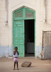 Kid Standing In Front Of An Ottoman Gren Door, Massawa, Eritrea (Eric Lafforgue) Tags: africa street travel people history childhood coral vertical architecture facade walking outdoors photography town alley women day child fulllength ottoman domesticlife turkish oneperson onepeople massawa eritrea hornofafrica eastafrica realpeople traveldestinations eritreo ottomanempire buildingexterior placeofinterest erytrea childrenonly eritreia colourimage africanethnicity 1people  massaoua ertra    eritre eritreja eritria builtstructure coastalfeature  rythre africaorientaleitaliana     eritre eritrja  eritreya  erythraa erytreja     ert6964