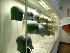 Hugh Inspecting a Row of Helmets (RobW_) Tags: bronze ancient hugh september greece tuesday olympia ilia helmets peloponnese 2013 sep2013 17sep2013
