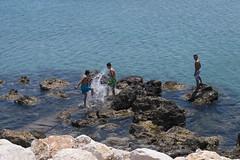 (mishacherkasov) Tags: boys play sea water sun sunshine stones rocks blue summer shore bay beach day daylight color colorphoto nikon nikonphotos nikond3200 nikonfamily greece rhodes island