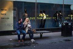 Love The Skinny Fit (Silver Machine) Tags: winchester hampshire streetphotography street candid couple sitting eating bench sandwich dummies mannequin shop shopwindow shopping windowdisplay fujifilm fujifilmxt10 fujinonxf35mmf2rwr
