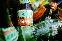 Empties, Kagurazaka (Eric Flexyourhead) Tags: kagurazaka  shinjukuku  tokyo  japan  city urban detail fragment bottles glass shine shiny empty emptybottles wine cocacola ricohgr