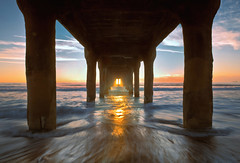 under the pier (Andy Kennelly) Tags: pier manhattan beach light waves water sand wet sunset stable solid pacific ocean california sun