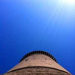 the tower (SS) Tags: above new city blue light sky italy sun white black tower weather vertical wall composition contrast skyscape square photography tivoli mood peace view angle pov walk year perspective scenic clear burning crop page rays framing minimalism bianco tone beams lazio celeste iphone noseup