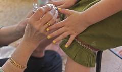 Painting her nails (PJD-DigiPic) Tags: macro yellow hands fingers granddaughter nails littlegirl nailpolish macroshot greenskirt coth glastonburyct pjddigipic paintingfingernailsyellow