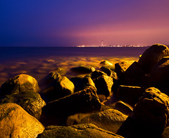 strange light (Andreas Hagman) Tags: longexposure pink blue light orange mist seascape green water fog night skyscraper rocks cityscape sweden streetlights stones empty nopeople le scandinavia malm resund uwa bo01 sigma1020mm calmwater turningtorso vstrahamnen n sonyslta77