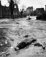 A dead German soldier lies next to a Panzerfaust in a town in north-west Europe during World War II, circa 1945. (Krueger Waffen) Tags: history infantry germany dead army war military wwii 1940s german ww2 killed kia ww 1945 panzer secondworldwar worldwartwo warfare panzerfaust wehrmacht germansoldier
