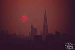 The Shard and the sun (Umbreen Hafeez) Tags: city uk red england sun building london tower silhouette architecture buildings dark europe cityscape gb shard bt