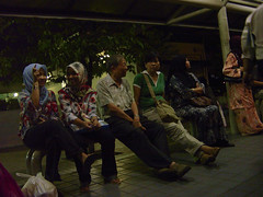 When we sit together (Hao Ran Lai) Tags: people building night person chinese oldman busstop sit commuter persons malay