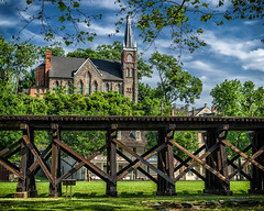 St. Peter's Church, Harpers Ferry (loco's photos) Tags: railroad trestle blue trees sky green leaves stone architecture clouds landscape wooden nationalpark catholic pentax gothic westvirginia harpersferry neogothic stpeterschurch fa31 k30 fa31limited pentaxart winchesterandpotomac