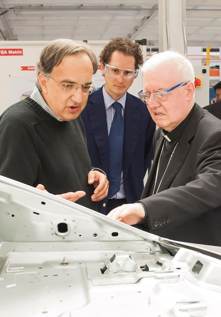 "The Archbishop of Turin, Cesare Nosiglia, visiting the new ""Avv. Giovanni  Agnelli Plant"" in Grugliasco"