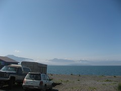 Homer Spit (smenjas) Tags: ocean blue sea sky mountains water grass car fog clouds truck buildings sand day dirty clear subaru trailer camper forester