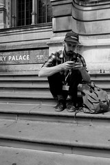Time to update his status (IanAWood) Tags: bw candid streetphotography va victoriaandalbertmuseum peoplewatching cromwellroad d3s walkingwithmynikon nikkorafs24mmf14g