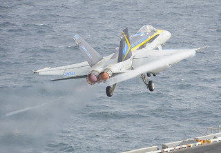 F/A-18C takes off from USS Nimitz in the Gulf of Oman.