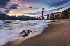 Enthroned (andywon) Tags: sanfrancisco bridge sunset sea sky usa mountains beach nature water colors rock architecture landscape sand colorful waves goldengatebridge shore goldengate hilly bakersbeach marshallbeach