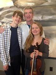 Teacher Patrick Hutchinson, Keegan Loesel, and Haley Richardson