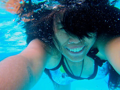 Underwater (mikeeliza) Tags: camera blue woman black hot sexy water girl beautiful smile swimming canon hair asian necklace big shiny long pretty underwater cross arms bare teeth philippines under young floating suit exotic manila shoulders pinay filipina brunette oriental eliza ancestors benedictine swimsuit wavy indonesian malay waterproof underwaterphotography negrita mainit mikeeliza