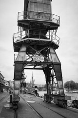 The Matthew viewed through a crane (Claire Young) Tags: blackandwhite film docks bristol ship crane matthew yashicat5 bristoldocks xp2super400