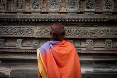 Orange tourist (Scalino) Tags: india karnataka tourism belur halebid halebeed halebeedu hoysala temple carved sculpture local tourists indian tourist woman orange henne hindu dark