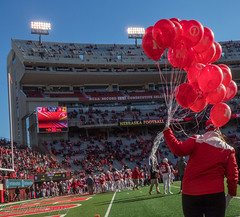 Huskers Balloon Tradition (Codydownhill) Tags: football game huskers big red sports portrait trophy brother dad