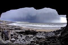 Gimme Shelter (pauldunn52) Tags: cave dunraven glamorgan heritage coast wales cliffs rocks beach hail clouds storm sea