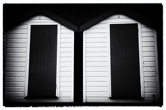 Numbers 14 and 15 (Simon Downham) Tags: bw black white beach hut huts 14 15 number numbers film noir old vintage minimal