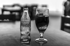 ice-cooled Coca cola (wildbam25) Tags: cola coca bokeh dof mono monochrome black white blackandwhite schwarz weiss sony ilce7m2 18 fe 50mm f18 drink ice cold