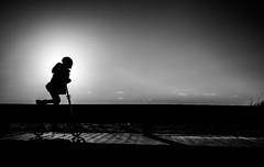 keep it rollin` (Dan-Schneider) Tags: streetphotography blackandwhite bw light olympus omdem10 monochrome contrejour human silhouette shadow sun