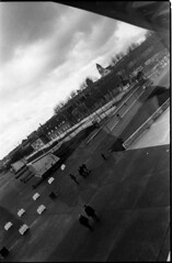 ... (icomewhenieatcaponata) Tags: people blackandwhite bw france reflection film museum architecture clouds analog 35mm canon walking eos mirror design frankreich nuvole view centre muse plus series hp5 analogue 300 lorraine pompidou francia ilford metz     peppopeppo puddicinu