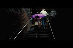 Emerging (Dj Poe) Tags: street new york city nyc light cinema color rain weather stairs zeiss umbrella 35mm canon movie subway photography eos still dj mark manhattan candid fake ii carl 5d cinematic raining tones emerging poe available 2012 5dmkii 5dmk2 distagont1435ze