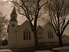 Church of the crooked steeple (jimsawthat) Tags: church sepia architecture colorado shadows stainedglass steeple smalltown us50 architecturaldetails manzanola
