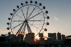 Big Wheel Sunset (Dave G Kelly) Tags: barcelona travel sunset vacation people music sun holiday primavera festival buildings circle concert spain ferris catalonia espana ferriswheel bigwheel primaverasound traveldestinations 2013