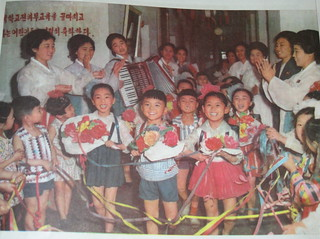 North Korea vintage DPRK propaganda photo from 1974 smiley kids singing and accordions -