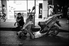 finally broken down (teknopunk.com) Tags: broken night waiting sitting crash scooter ratbike oneman gaffertape leicammonochromsn4342460 28f2summicronasphsn4007810
