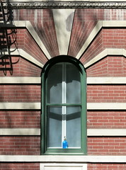 Blue bottle, West 10th Street, Greenwich Village, New York City (Hunky Punk) Tags: city nyc blue houses windows usa ny newyork streets west brick lines architecture buildings arch apartment bottles manhattan stonework cities artdeco 10th rounded neighborhoods greenwichvillage fireescapes tenth windowsills hunkypunk spencermeans
