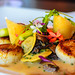 Seared dayboat scallops with morel mushroom, asparagus two ways, and a truffle cream sauce at Troquet