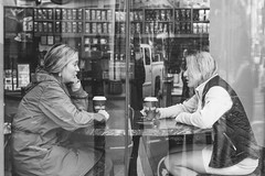 Conversation Over Coffee (Jeremy Brooks) Tags: bw blackwhite blackandwhite california people philzcoffee sanfrancisco sanfranciscocounty usa window camera:make=fuji camera:make=fujifilm camera:model=xpro1