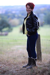 Country Life (thestourman) Tags: bokeh leather jacket black yellow polo shirt woman canon l lens 6d 135mm prime countryside england suffolk blur blue jeans grass boots