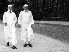 Two guys walking along Avenue Mohammed V ((Imagine) 2.0) Tags: panasonicdmcgx80 2016 morocco leicadgsummilux15mmf17 marrakech streetphotography people bw blackandwhite candid monochrome tourism walking panasonic lumix travel